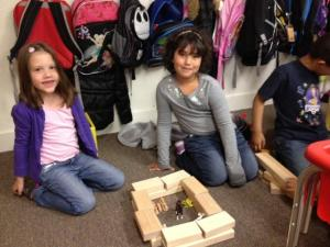 Hannah and Nevasiah build a farm in the blocks lab.