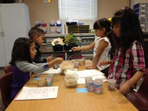 Abbigail, Edwyn, Karime, and Jazmin make squirrel feed during a math lab.