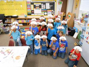 On a Friday morning during STaR, kindergarteners made owl masks after hearing Martin Waddell's story Owl Babies.