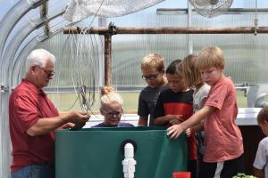 fourth  graders feed the fish