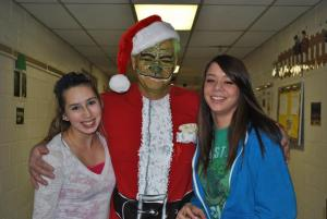Sophomores girls give the Grinch a hug.