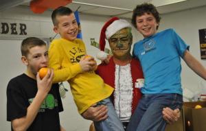 The Grinch hoisting up sixth grade boys.