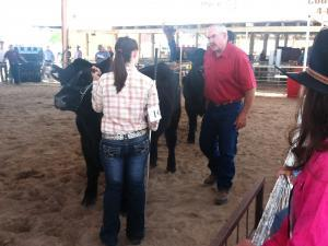 Tessa and Judge Mr. Johnson critiquing the steer