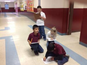 Mrs. Barrios' first grade class working on their Social Studies PBL.