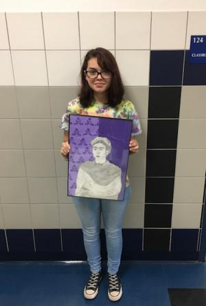 Priscilla Elizalde poses with her drawing of Frida Kahlo.
