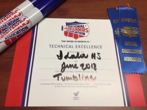 Technical Excellence Award for Tumbling, 3 superior ribbons (chant, cheer, and mascot) and 2 spirit sticks (cheer & mascot)