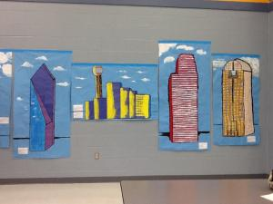 Students painted large representations of the Dallas skyline.
