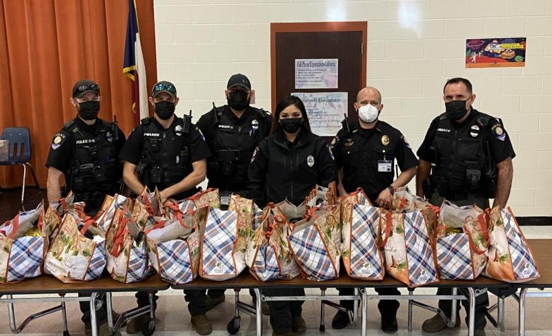 BEEVILLE ISD POLICE DEPARTMENT HOSTS 1ST ANNUAL TROJAN THANKSGIVING; DISTRIBUTES THANKSGIVING BASKET