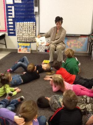 Mrs. Lloyd reading One, Fish Two, Fish Red Fish, Blue Fish