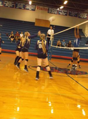 Whitney Weaver executing a push attack vs. Arkadelphia