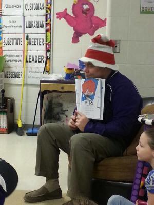 Mr. Parrish reading Cat in the Hat