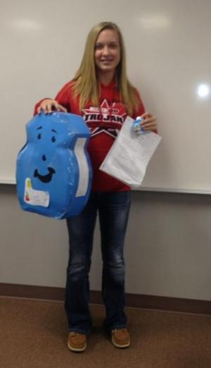Madison Elkins with her super sized kool aid flavoring (8th grade)