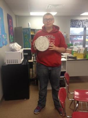 Gage Tollette with his super sized dime (9th grade)