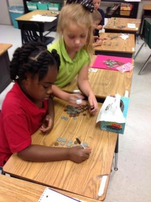 Peer tutoring during Money Counting stations