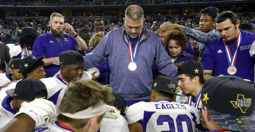 (Coach Johnston and the Eagle football team after the 2018 Championship)