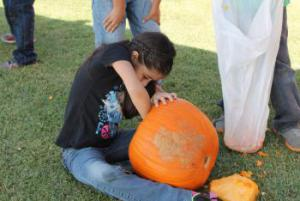 Scraping all the ooey gooey out of the inside of the pumpkin!