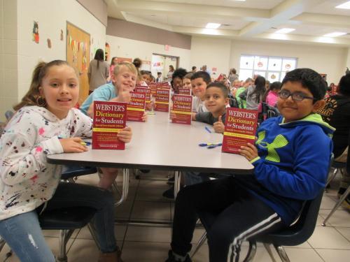 The De Queen Rotary Club distributes dictionaries to all third grade tudents at De