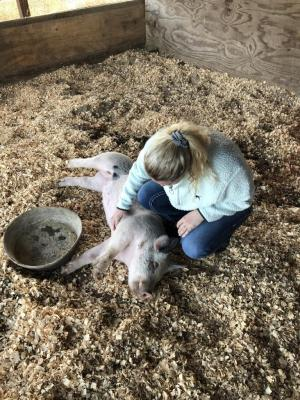 Loren Vandroec spending quality time with her show pig, Petunia.