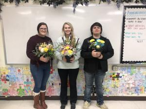 Floral design class creating their first arrangements- Hannah Jamison, Loren Vandrovec and Matthew Gamble