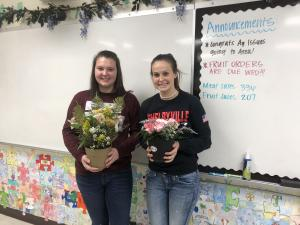 Floral design class creating their first arrangements- Mattison Clay and Paige Shedd