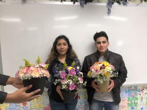 Floral design class creating their first arrangements- Ana Zamora and Adam Hernandez