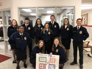 FFA Officers starting off National FFA Week by greeting the elementary kids when they get to school