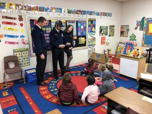 Jordan Williams, Michael Spears and Samantha Ferrebee playing a game with Kindergarten for FFA Week