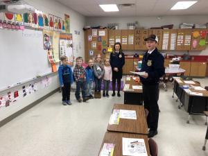 Logan Williams and Avery Faulkner playing a game with Kindergarten for FFA Week