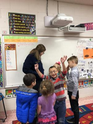 Hannah Jamison playing a game with Mrs. Jada's Kindergarten class for FFA Week