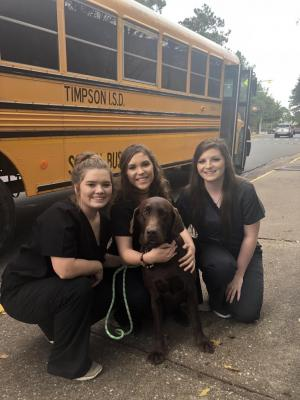 2018 Senior Skills Demonstration team presenting how to do a vet exam on Mrs. Fallin's dog, Gauge.