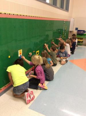 Students working on the new Lego wall.