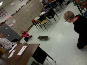 Students used a skateboard and an empty soda can to explore Newton's First Law of Motion.