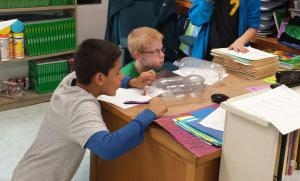 Students explored air pressure with a bottle and a ball of paper.