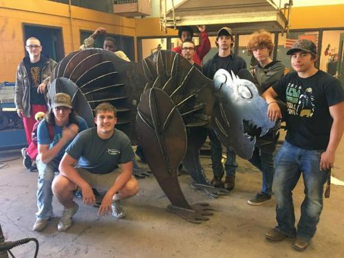 welding students with bear