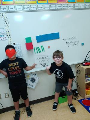 Third grade working together to show place value in various forms.