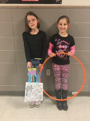 Kirstyn and Maddie won the coloring contest conducted by the Cafeteria.