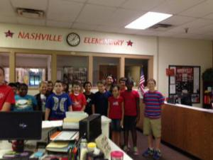 5th grade students singing The Star Spangled Banner over the intercom
