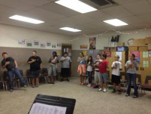 6th grade students singing The Star Spangled Banner in class