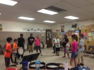 6th grade students playing hand drums in class