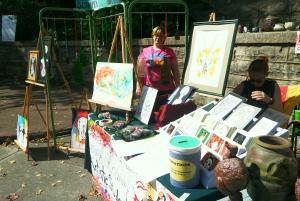 Selling art in the hot sun.