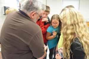 Braden, Kirstyn and Kaylee learn magic from area magician, Larry Bean.