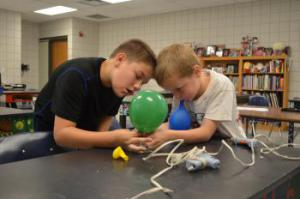 Cooper and Braden cooperate to assemble a hovercraft.