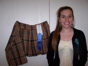 Lilly is pleased with her first place finish on her clothing project.