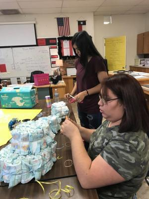 Baby Shower - students working on diaper cake
