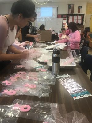 FCCLA members have an assembly line to organize cookies.