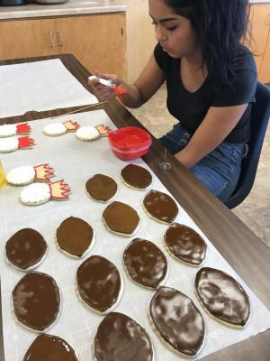 Homecoming Cookie Fundraiser - Danielle begins the icing and decorating