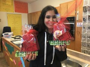 Homecoming Cookie Fundraiser - Dora shows off the final product