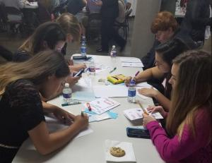 Iola FCCLA chapter members creating cards for the military overseas during the holiday season.