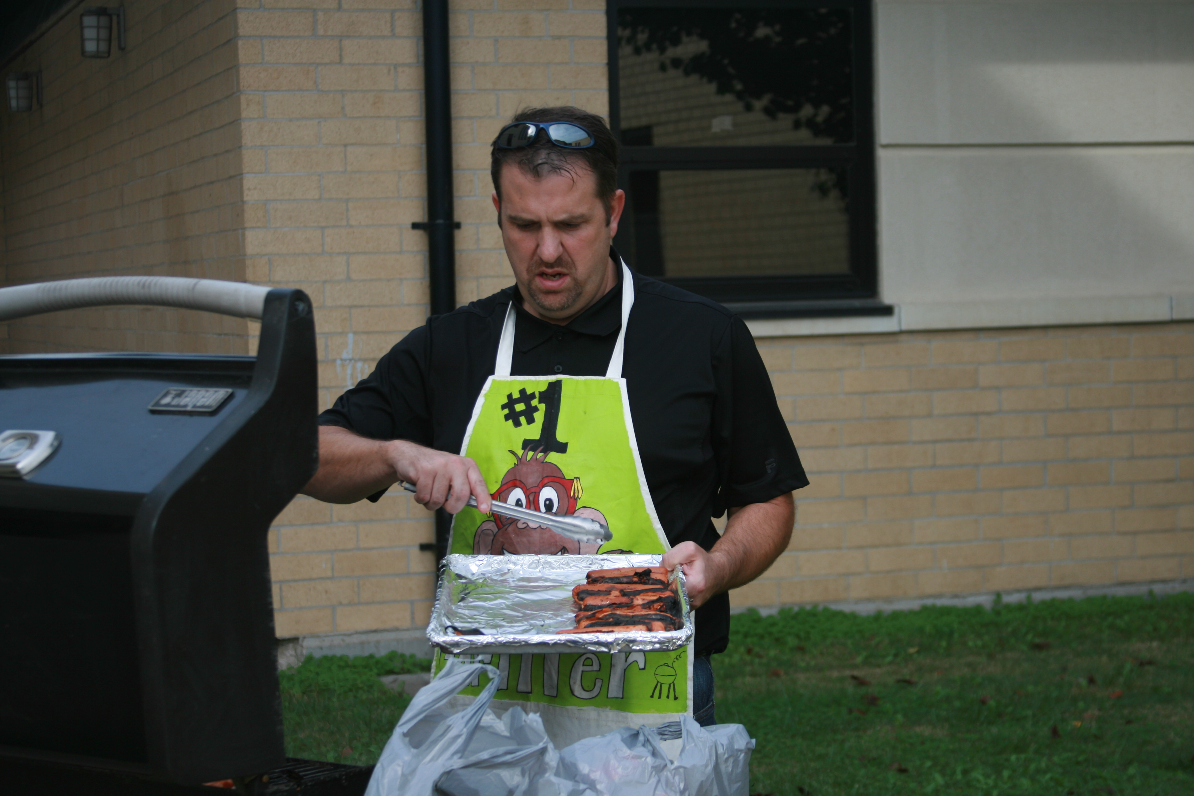 Mr. M cooking up the hotdogs on the 24th for the A.R. cookout.