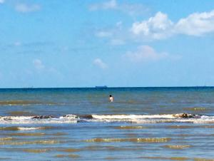 Swimmer wading out - Galveston